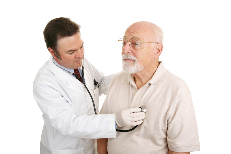 Elderly man getting his heart checked by a doctor in Dallas, TX