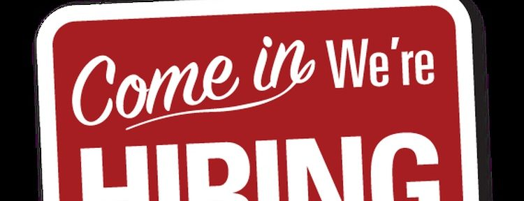 Red hiring sign for Home Care Assistance in Dallas, TX